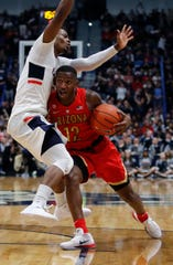 Arizona Wildcats guard Justin Coleman (12) drives the ball against Connecticut Huskies guard Alterique Gilbert (3) in the second half at XL Center. Arizona defeated UConn 76-72 Dec. 2, 2018. David Butler II-USA TODAY Sports
