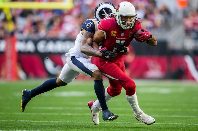 499fb864de218a Cardinals  Larry Fitzgerald runs after a catch against the Rams in the 1st  half on