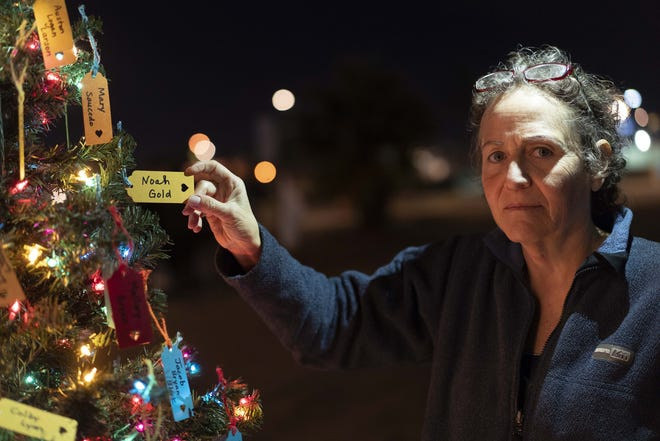 Ingrid Gold, who lost her 21-year-old son Noah from drug overdose put his names on a Christmas Tree in downtown Phoenix. Each name was written on a tag and hung on a Christmas tree. Since June 15, 2017, when the department began collecting opioid data in real time, through Dec. 20, 2018, the state has recorded more than 2,500 suspected opioid overdose deaths.