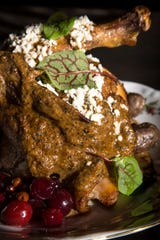 Roasted chicken with peanut mole at Cotton & Copper in Tempe.