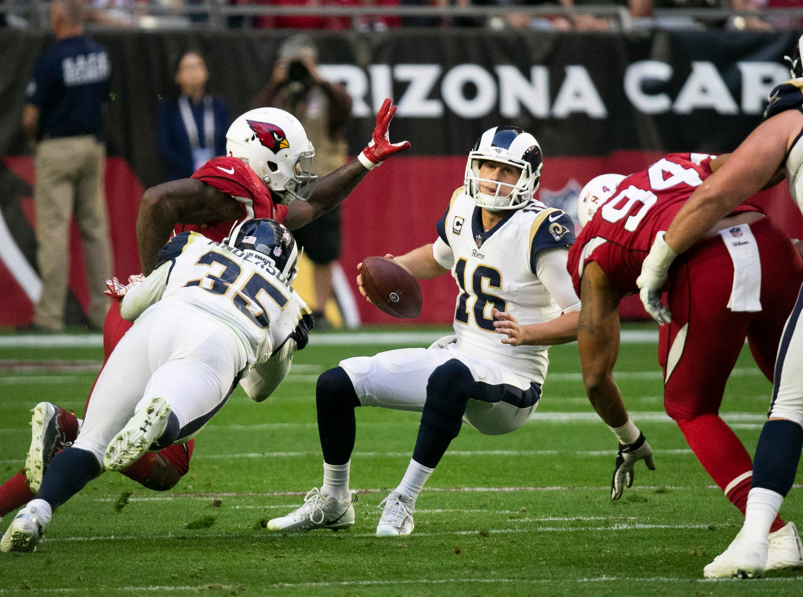 Rams quarterback Jared Goff stumbles as Cardinals linebacker Haason Reddick puts on the pressure during the fourth quarter of the NFL game at State Farm Stadium in Glendale on Sunday, December 23, 2018.