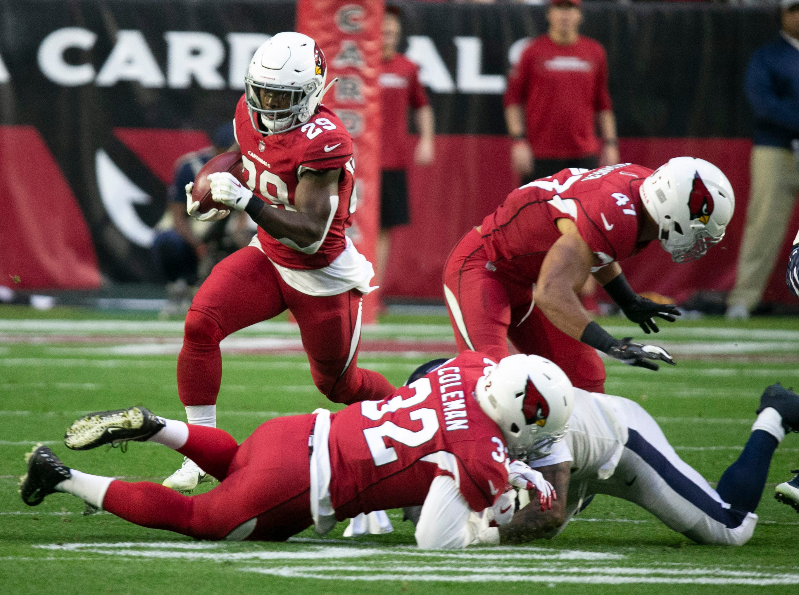Cardinals running back Chase Edmonds carries the ball against the Rams during the fourth quarter of the NFL game at State Farm Stadium in Glendale on Sunday, December 23, 2018.
