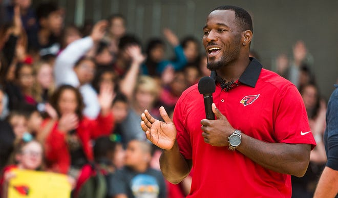 Arizona Cardinals fullback Derrick Coleman, the NFL's first legally deaf offensive player, speaks to an assembly of students, parents and teachers at the Phoenix Day School for the Deaf, Tuesday, November 27, 2018.