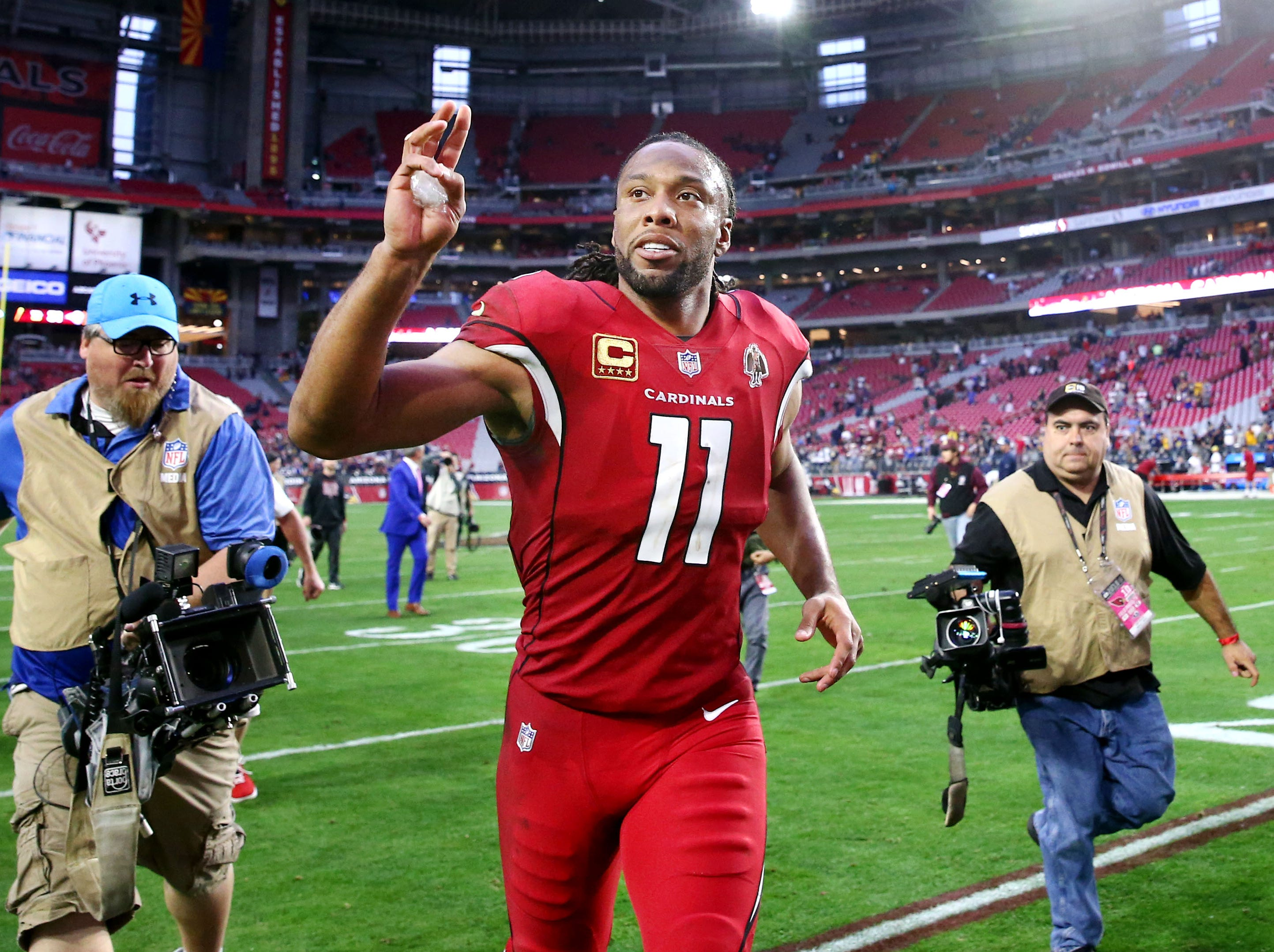 Arizona Cardinals wide receiver Larry Fitzgerald waves to the fans after their 31-9 loss to the Los Angeles Rams on Dec. 23 at State Farm Stadium.