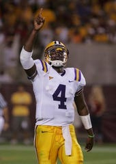 LSU quarterback JaMarcus Russell threw a 39-yard touchdown pass with 1:13 left lifting LSU to a 35-31 win over Arizona State in 2005.
