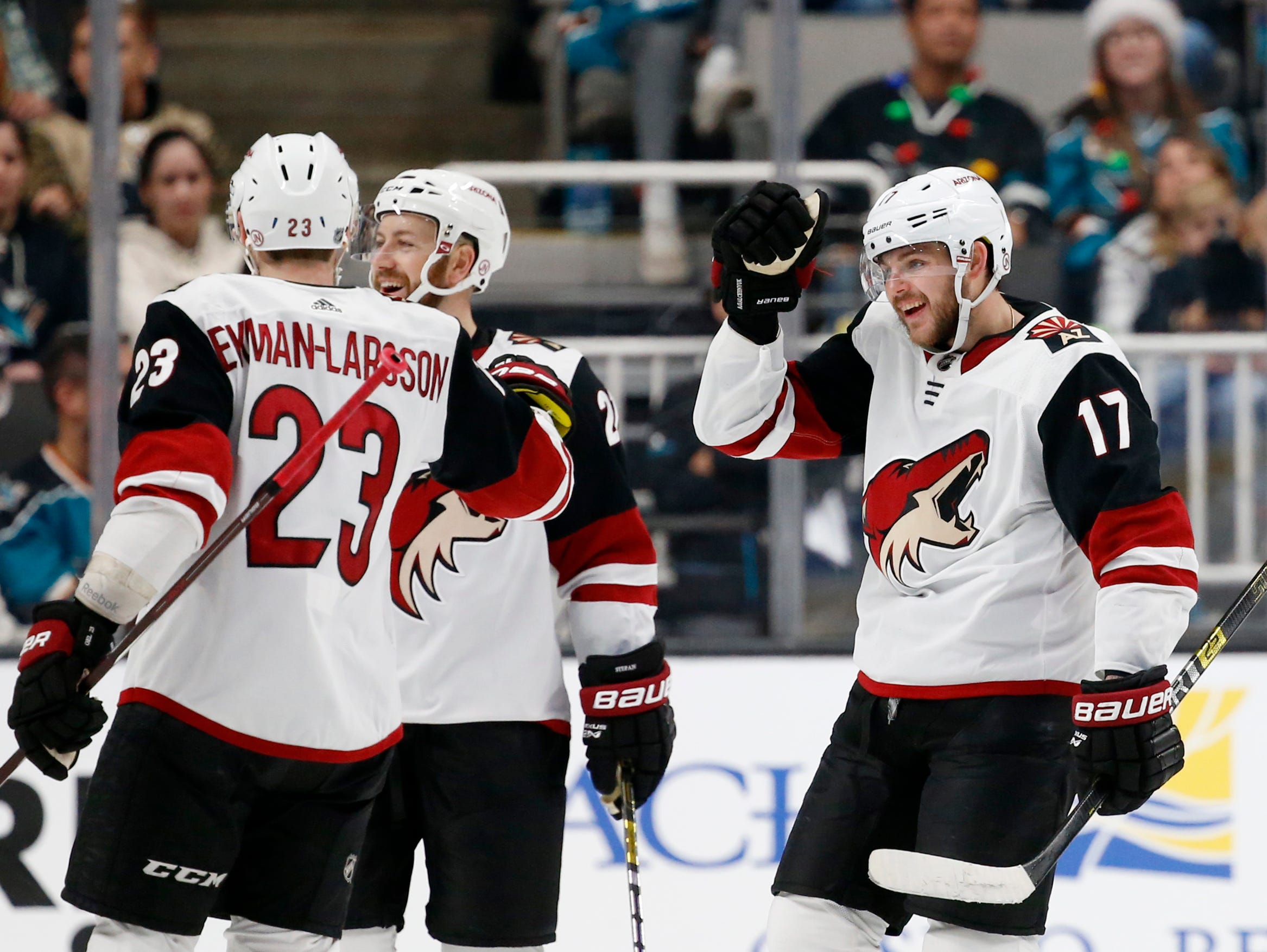 Arizona Coyotes' Alex Galchenyuk (17) celebrates with Oliver Ekman-Larsson (23) after scoring his second goal of the night against the San Jose Sharks in the second period of an NHL hockey game in San Jose, Calif., Sunday, Dec. 23, 2018. (AP Photo/Josie Lepe)
