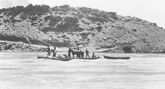 A historic photo shows travelers crossing the Colorado River at Lees Ferry, which operated from about 1872 to 1928, when Navajo Bridge was built.