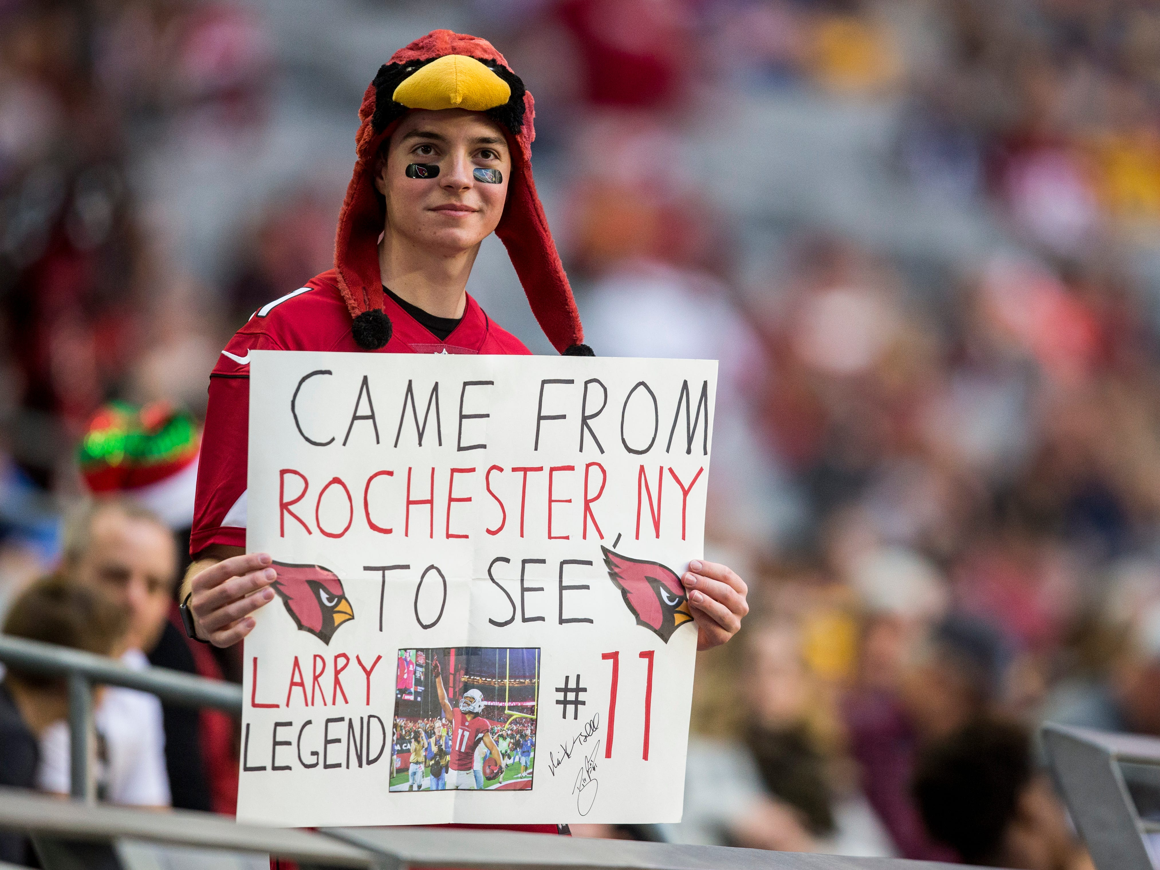 Jonah Sharp, 21, holds a sign for Larry Fitzgerald before the Cardinals game against the Rams on Sunday, Dec. 23, 2018, at State Farm Stadium in Glendale, Ariz.