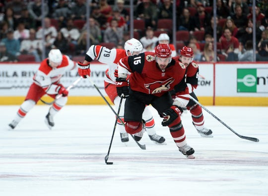 Coyotes center Brad Richardson carries the puck up the ice during a game against the Hurricanes at Gila River Arena.