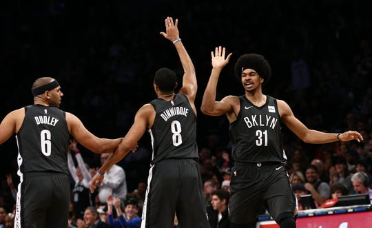 Dec 23, 2018; Brooklyn, NY, USA; Brooklyn Nets forward Jared Dudley (6) and guard Spencer Dinwiddie (8) and center Jarrett Allen (31) react in the first quarter against the Phoenix Suns at Barclays Center. Mandatory Credit: Nicole Sweet-USA TODAY Sports