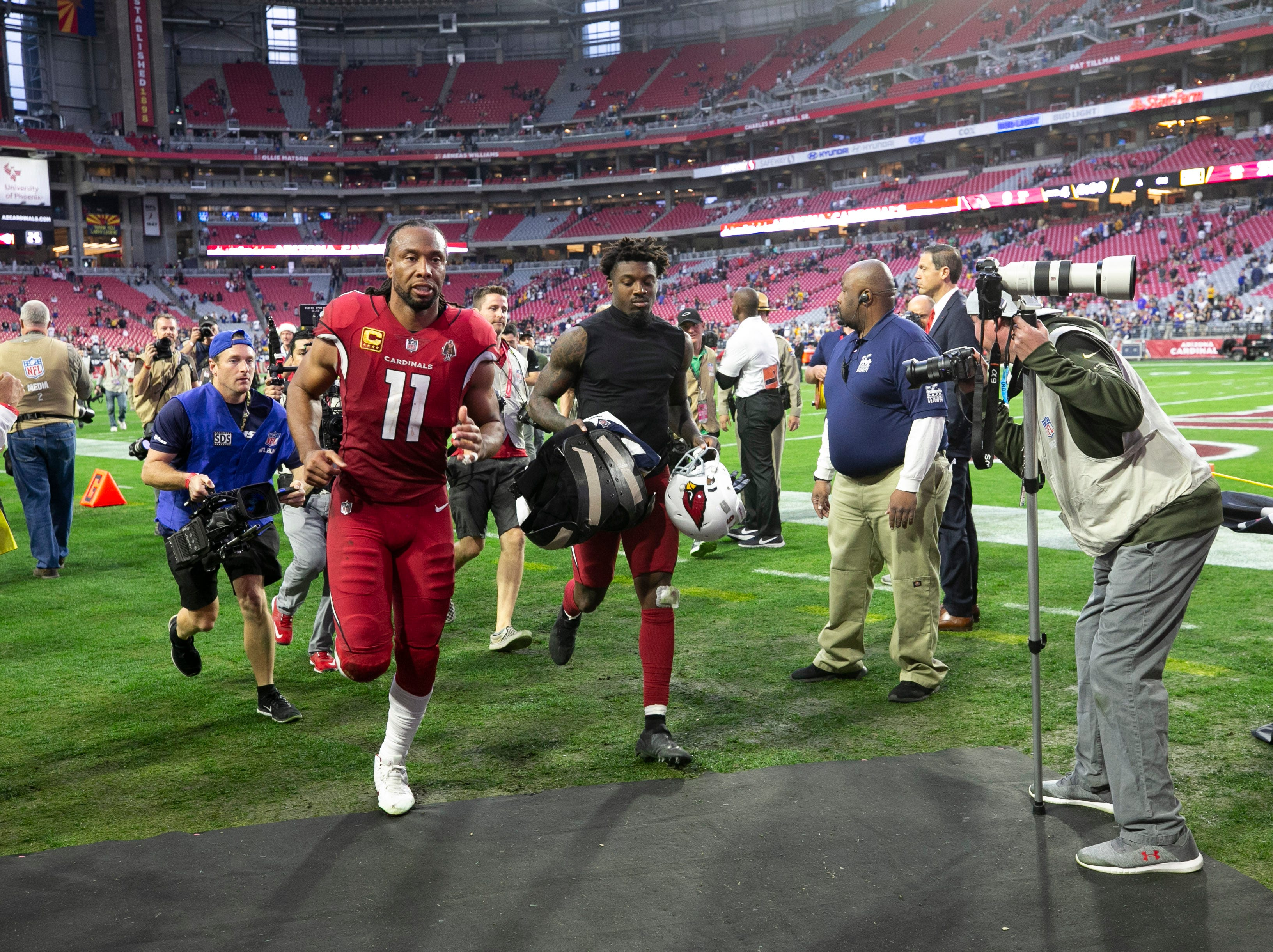 Cardinals wide receiver Larry Fitzgerald runs off the field after the Cardinals 31-9 loss to the Rams during the NFL game at State Farm Stadium in Glendale on Sunday, December 23, 2018.