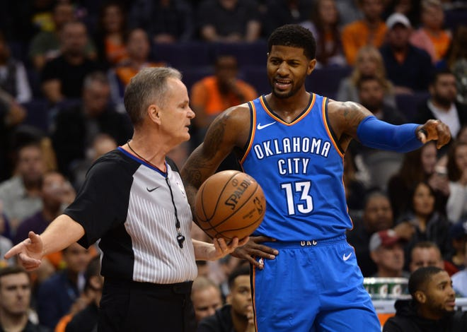 Thunder forward Paul George questions a call by referee Mike Callahan during the first half of a game against the Suns on Nov. 17 at Talking Stick Resort Arena.