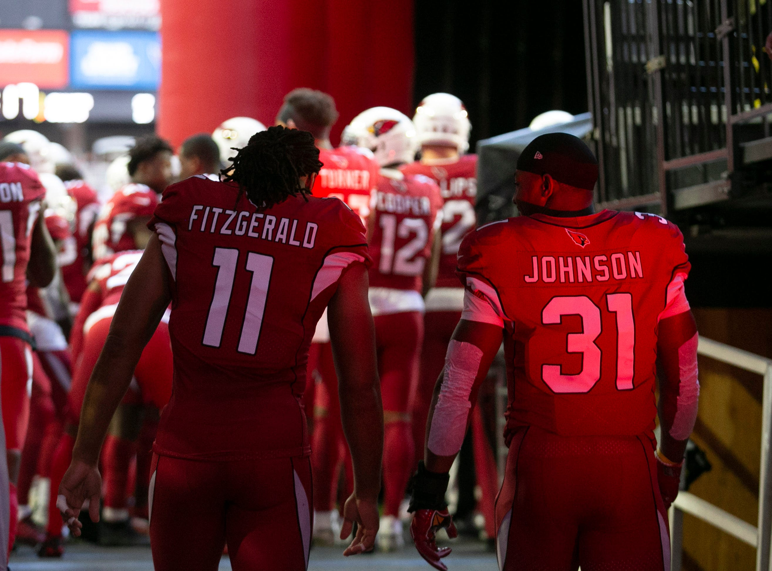 Cardinals wide receiver Larry Fitzgerald and running back David Johnson walk to the field before the game against the Rams at State Farm Stadium in Glendale on Sunday, Dec. 23, 2018.