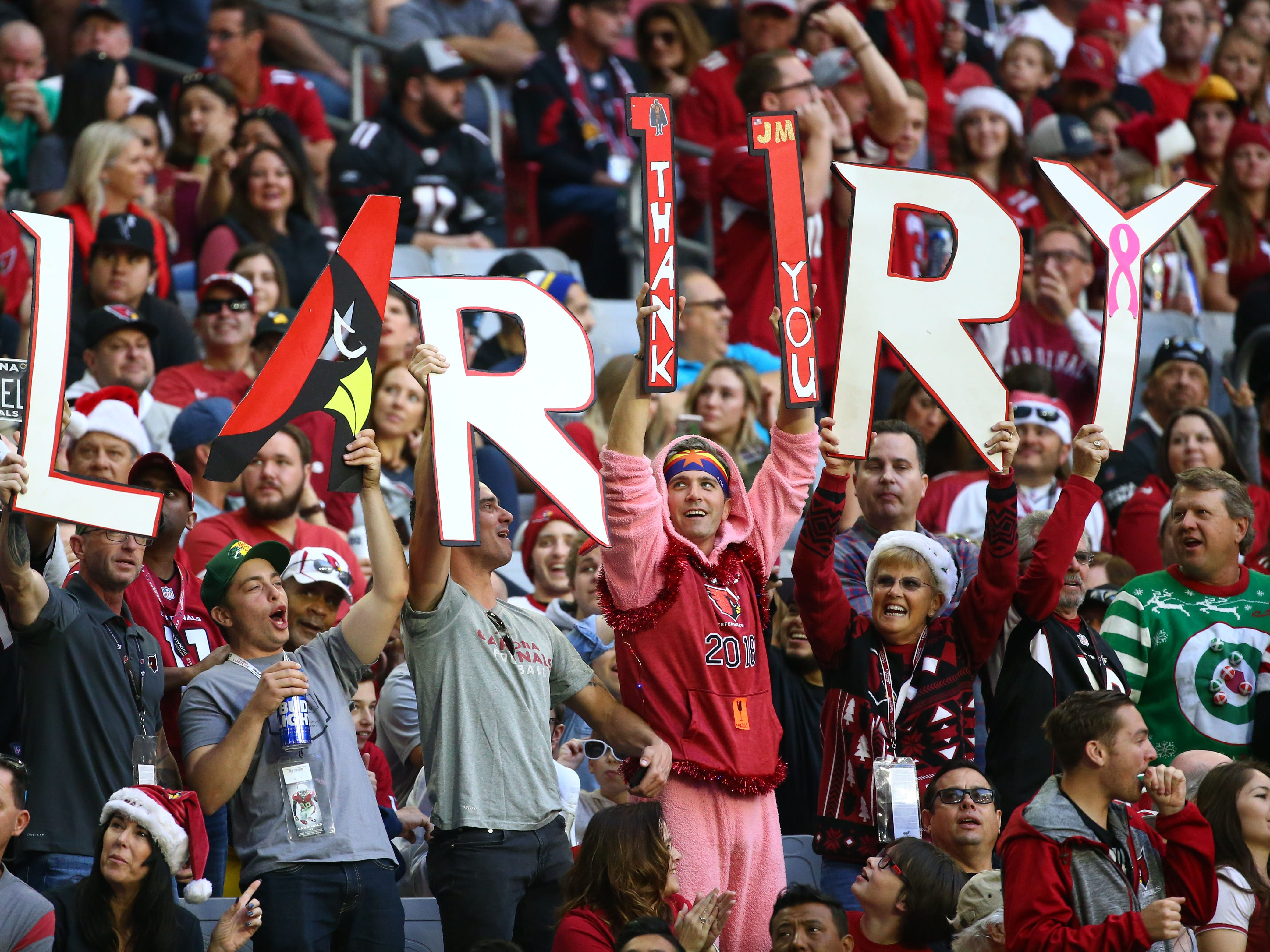 Arizona Cardinals fans cheer for Larry Fitzgerald in the first half on Dec. 23 at State Farm Stadium.