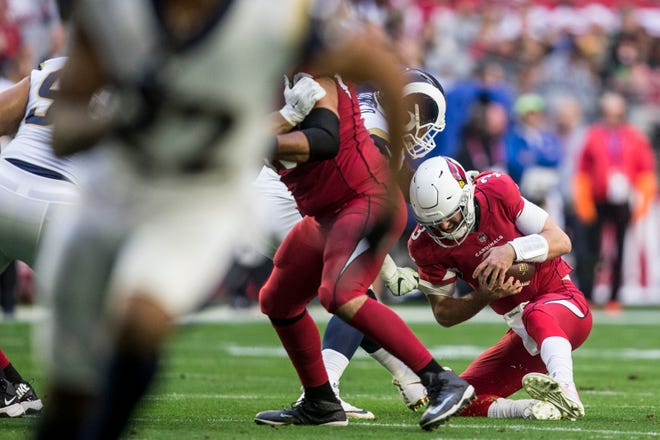 Cardinals' Josh Rosen is sacked against the Rams in the 1st half on Sunday, Dec. 23, 2018, at State Farm Stadium in Glendale, Ariz.