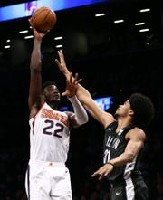 Dec 23, 2018; Brooklyn, NY, USA; Phoenix Suns center Deandre Ayton (22) puts up a shot against Brooklyn Nets center Jarrett Allen (31) in the second quarter at Barclays Center. Mandatory Credit: Nicole Sweet-USA TODAY Sports
