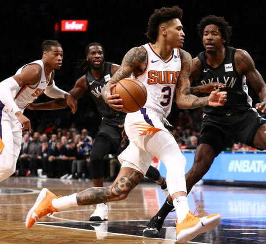 Dec 23, 2018; Brooklyn, NY, USA; Phoenix Suns forward Kelly Oubre Jr. (3) drives to the basket against Brooklyn Nets forward Ed Davis (17) in the first quarter at Barclays Center. Mandatory Credit: Nicole Sweet-USA TODAY Sports