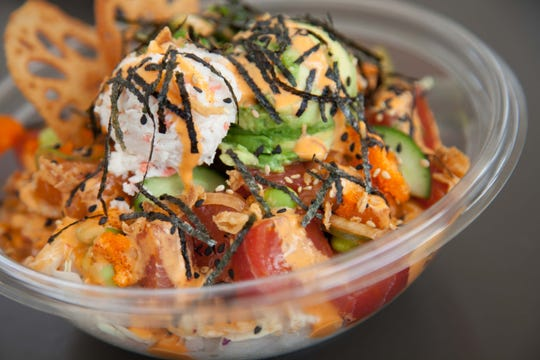 Pokéworks is a fast-casual poke restaurant that specializes in Hawaiian-inspired poke bowls and burritos.