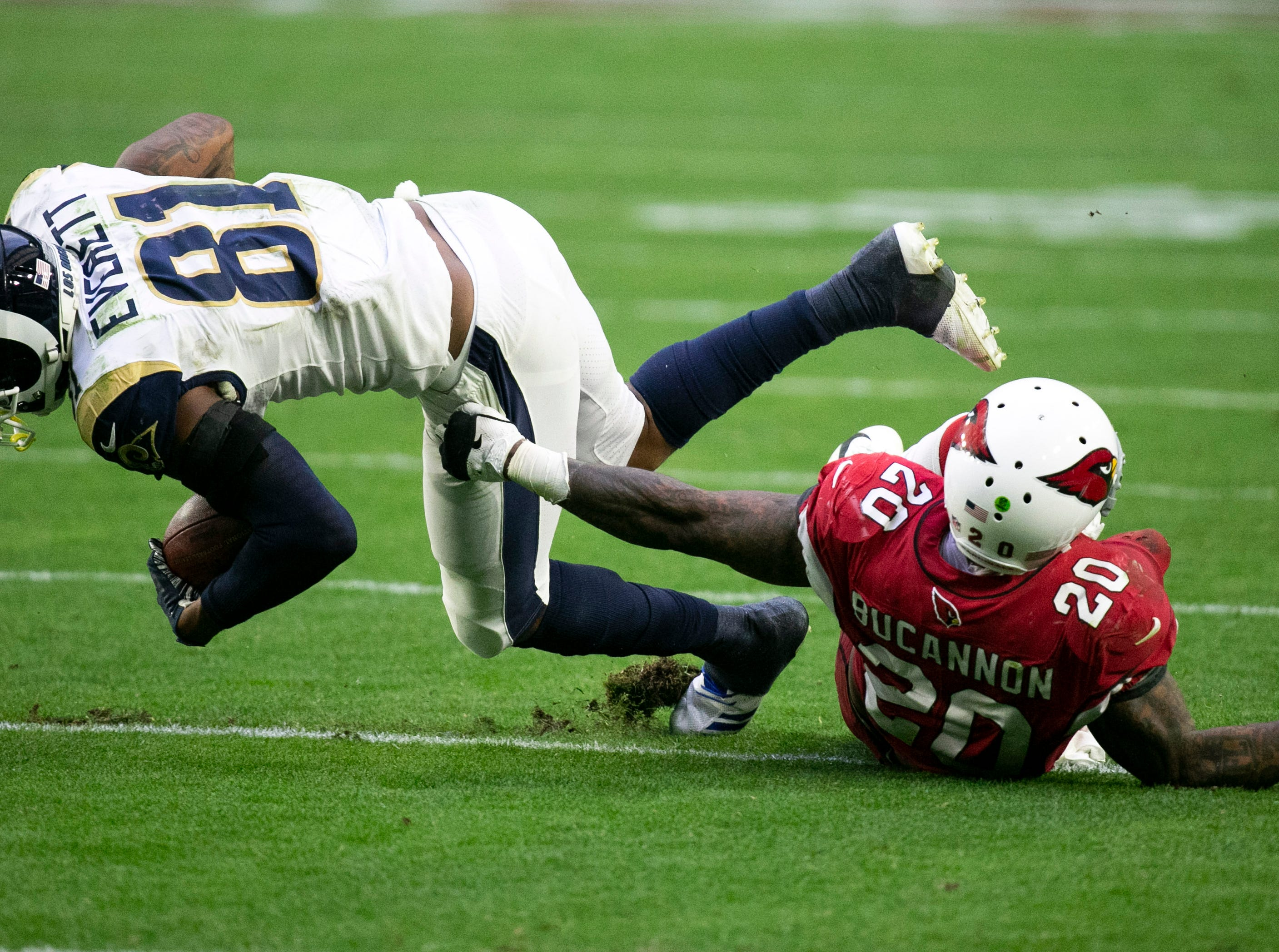 Cardinals linebacker Deone Bucannon attempts the tackle on Rams tight end Gerald Everett during the fourth quarter of the NFL game at State Farm Stadium in Glendale on Sunday, December 23, 2018.