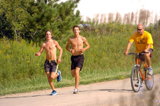 Craig Dickinson takes runners through a workout while at Port Huron Northern.