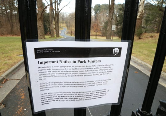 A message from National Parks Service that the Vanderbilt Mansion Historic Site is closed due to the government shutdown on December 24, 2018. The gates to the site were locked.