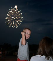 Alex Sentz, 2, of Red Lion, reacts to fireworks he watched from the parking lot at Red Lion High School Tuesday, July 3, 2018. The fireworks were being set off from an athletic field at the nearby junior high school. Bill Kalina photo