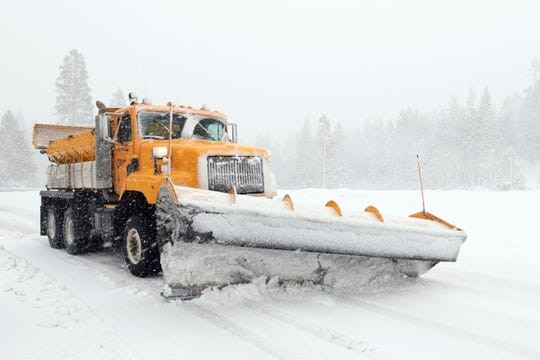 A Nevada Department of Transportation snowplow heads up the Mt. Rose Highway on Dec. 24, 2018.