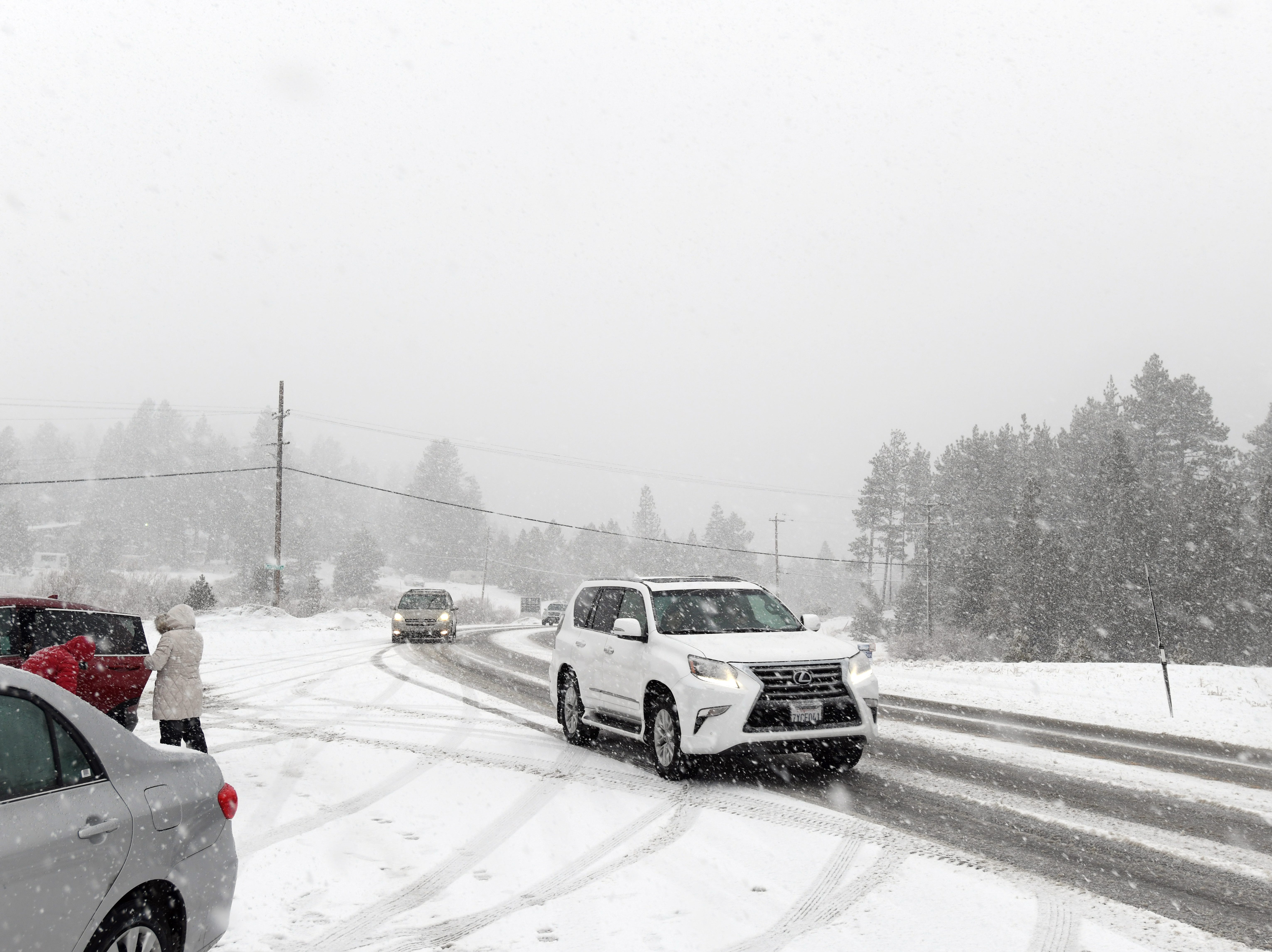 An SUV heads up the Mt. Rose Highway as heavy snow falls on Christmas Eve 2018.