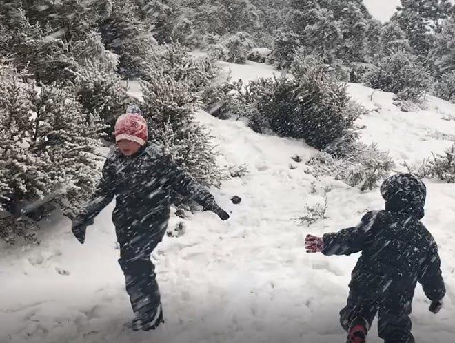 Children play in the snow near Tannenbaum  on Mt. Rose Highway near Reno on Monday, Dec. 24, 2018.