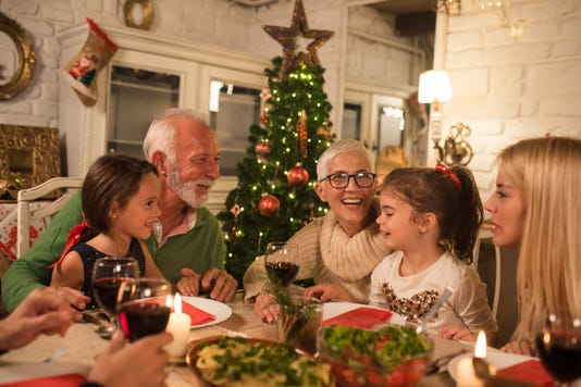 Happy Family At Christmas Dinner Party