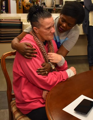 Viviane Mukangamije, 38, embraces a woman at the Simonka Place in Keizer on Dec. 23, 2018.