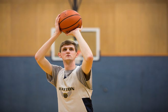 Stayton High School's Kaleb Anundi, a six-foot-eight senior center, shoots at the line during practice in Stayton on Thursday, Dec. 20, 2018.