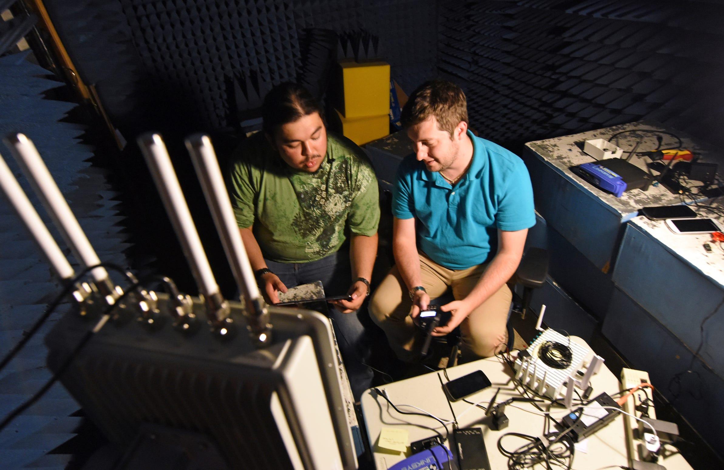 INL interns Armando Juarez Jr., left, and Jordan Mussman work in the Faraday room in a cybersecurity electronics lab in Idaho Falls, Idaho.