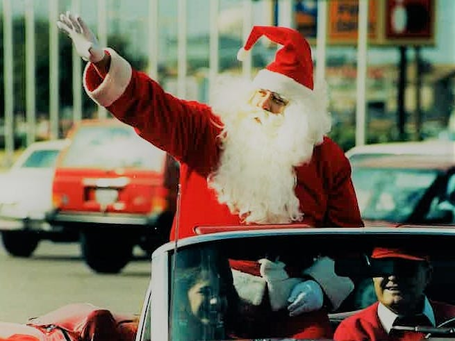 Santa Claus arrives at the Stadium Park Shopping Center on Nov. 29, 1991 in a convertible with Natalee Kirking and Bill Gregg.