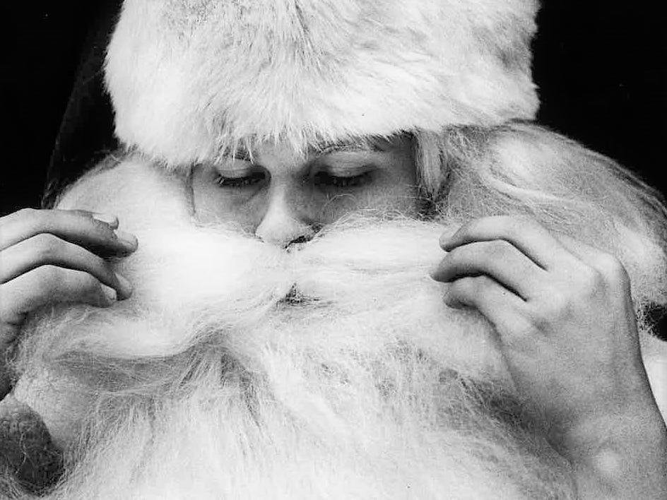 Santa – aka Tim Soukup – adjusts his beard and mustache as he gets ready to see the many youngsters at Sunset Mall on Dec. 18, 1981.