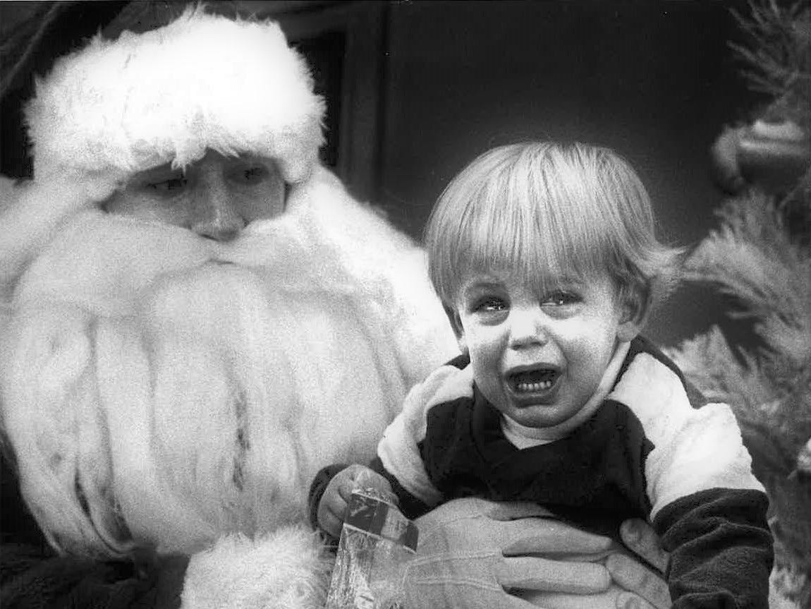 "This sad boy and the Santa holding him weren't identified in this photo from the Standard-Times archives dubbed ""no smile."" Information about the year the photo was taken and the photographer also wasn't available. Do you know who this kid is and/or Santa? Send us an email at news@gosanangelo.com."