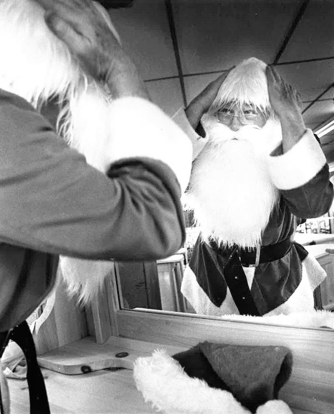 No information accompanies this photo from the Standard-Times archives of Santa adjusting his white hair. The only details offered were that it was shot on a Monday evening by photographer Scott Campbell.