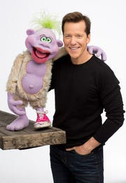 Comedian and ventriloquist Jeff Dunham poses with sidekick Peanut.