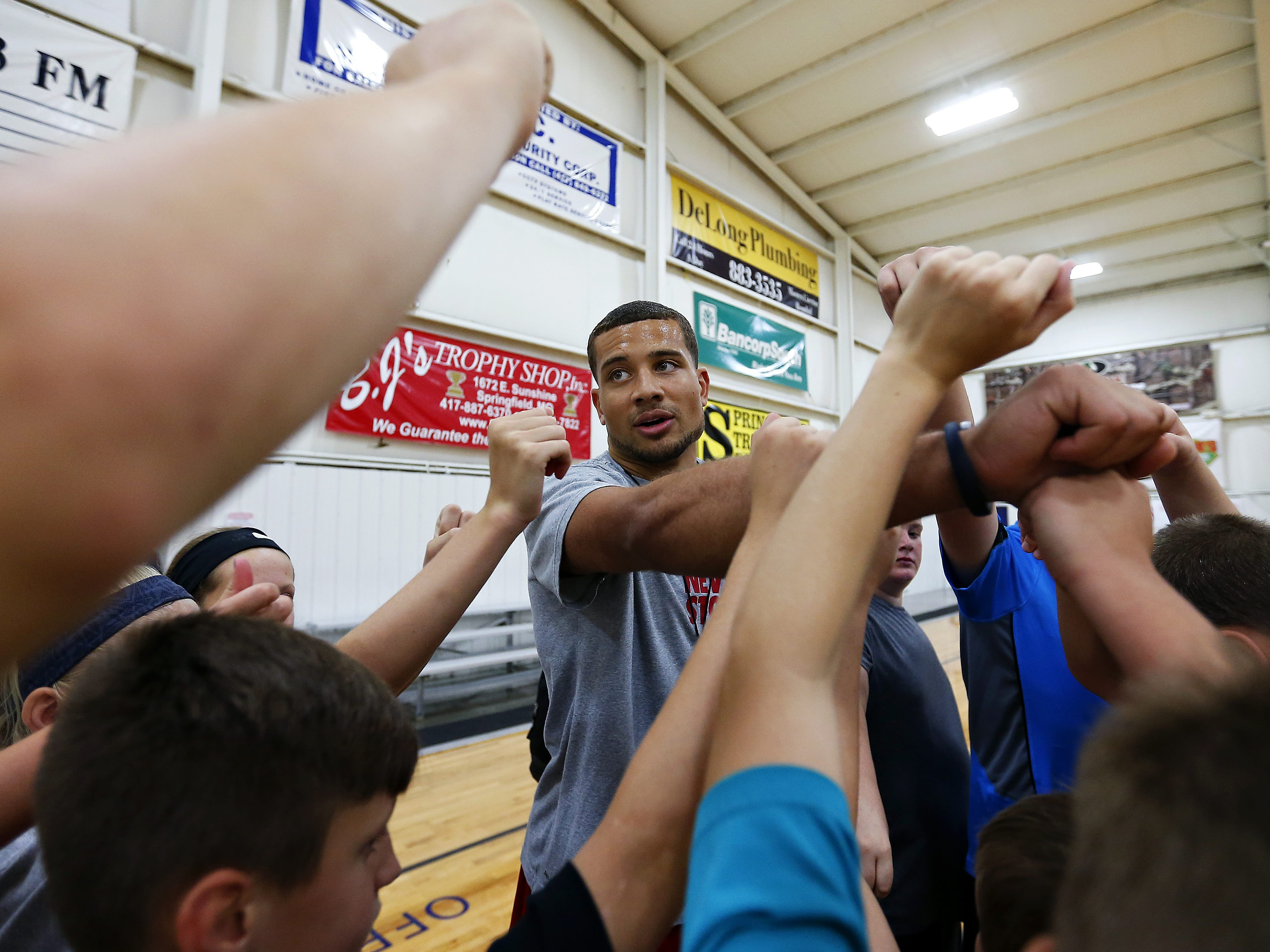 Former Missouri State basketball star Kyle Weems breaks down his camp attendees for the day at the Courts E-Zone in Springfield, Mo. on July 28, 2015.