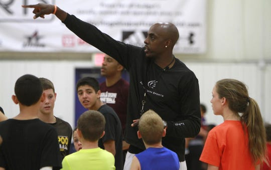 Phoenix Suns basketball player Anthony Tolliver gives instructions to kids during his basketball camp at The Courts on Tuesday, July 22, 2014.