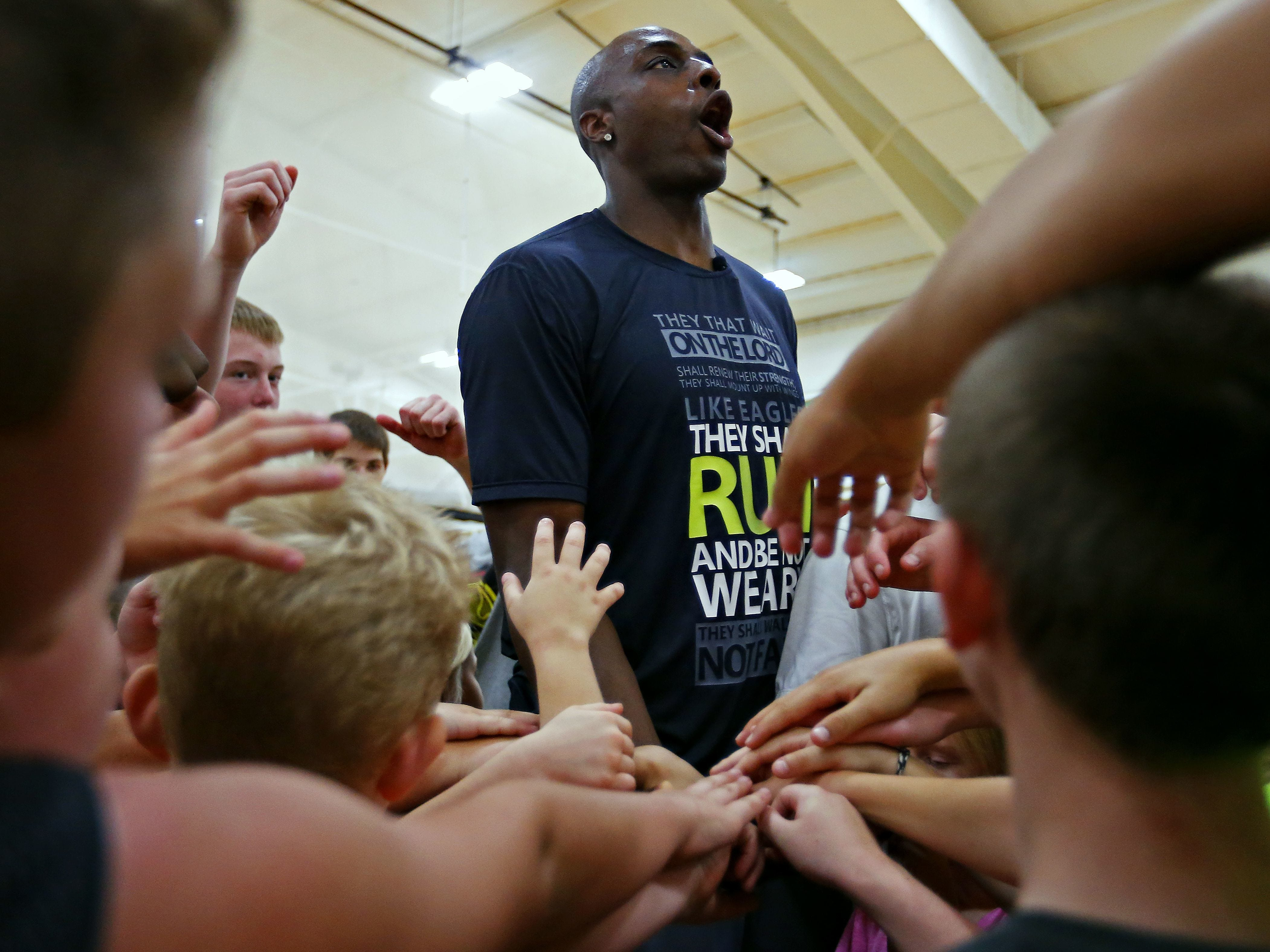 Springfield native Anthony Tolliver huddles up with the kids attending his annual basketball camp at The Courts E-Zone in Springfield in 2015.