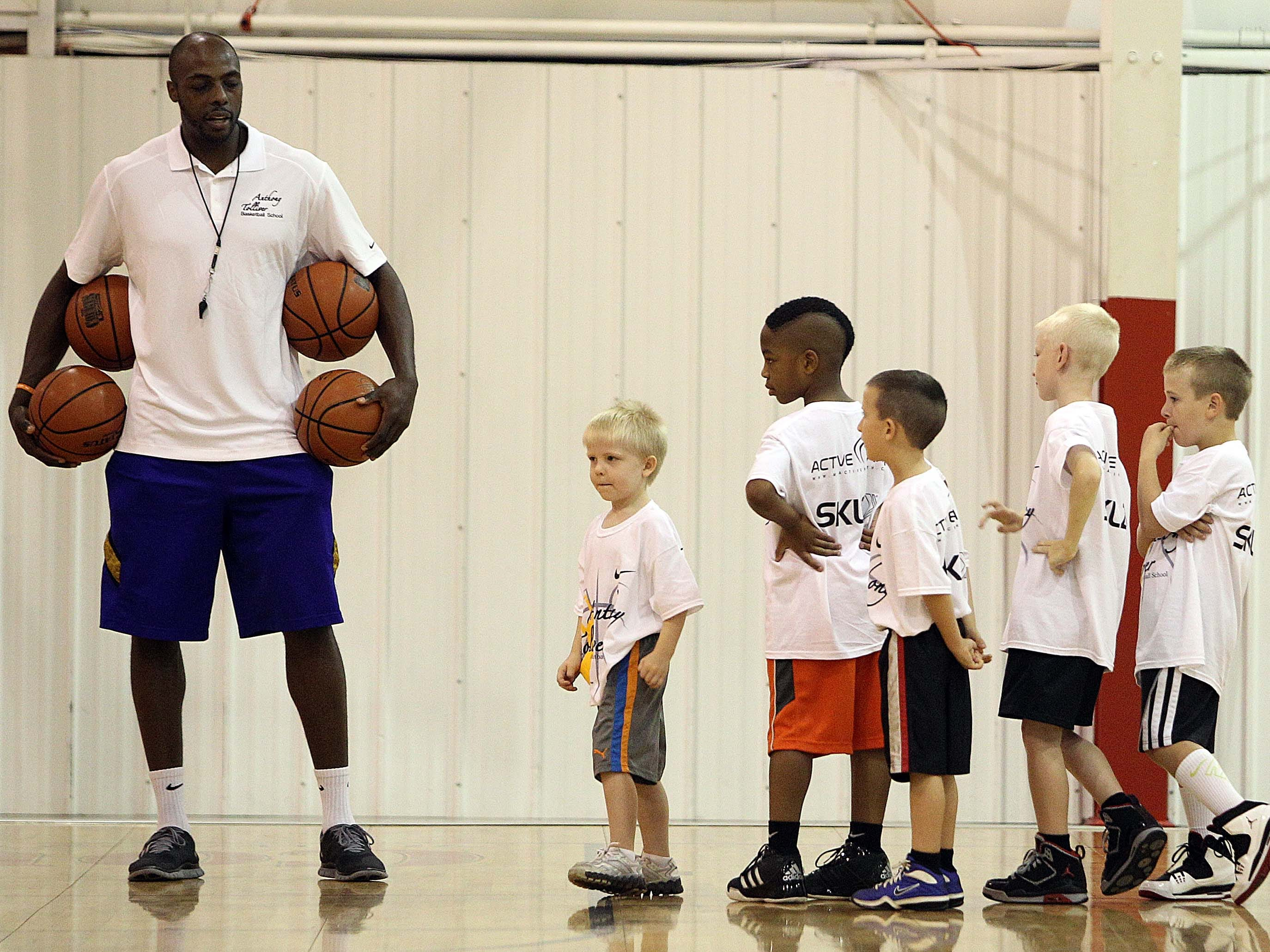 Anthony Tolliver works with some of the youngest members of his camp at The Courts in Springfield.