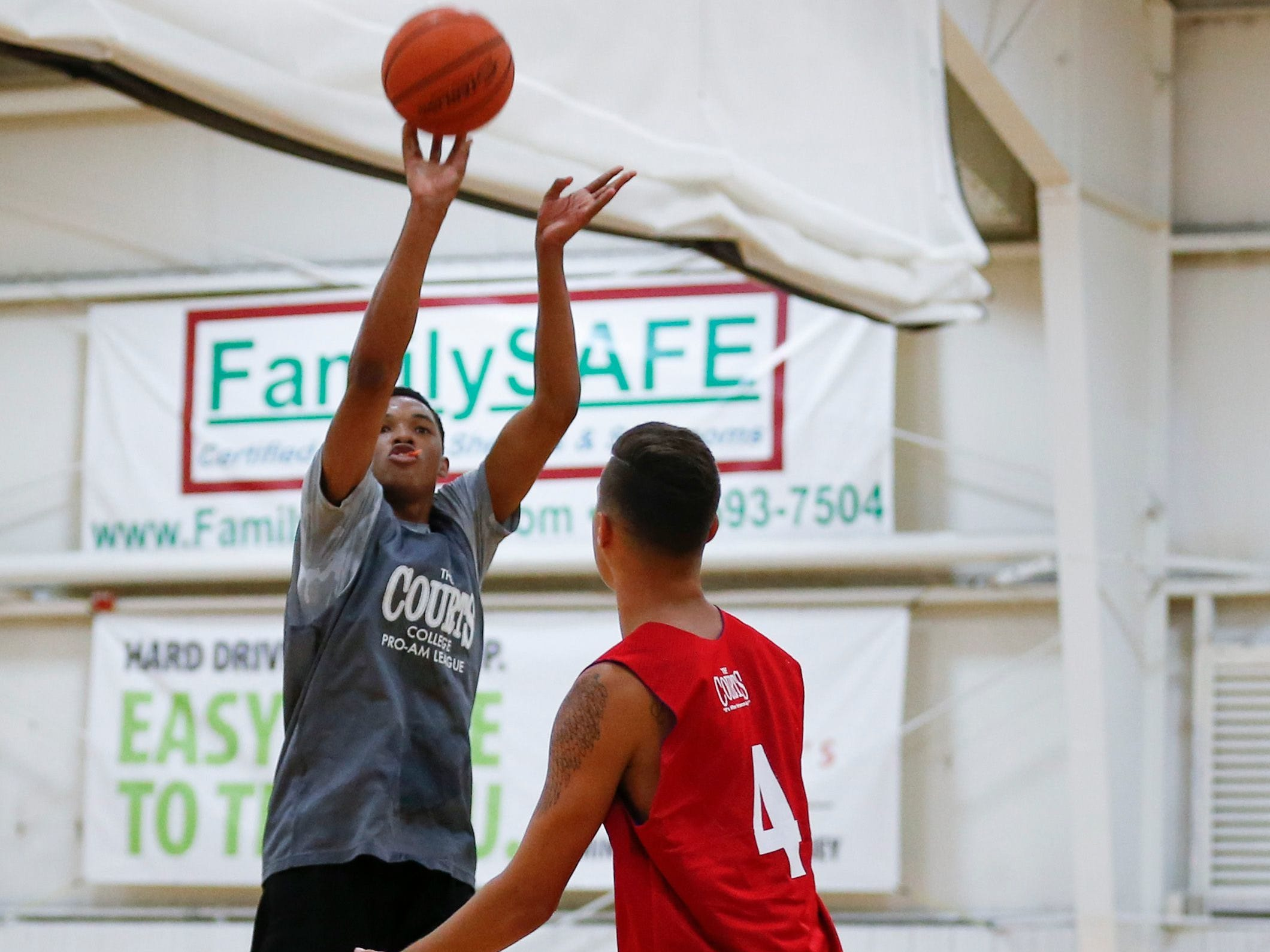 Tyem Freeman shoots a basket during a game at the 19th Annual Men's & Women's College Pro am League at The Courts on Wednesday, June 20, 2018.