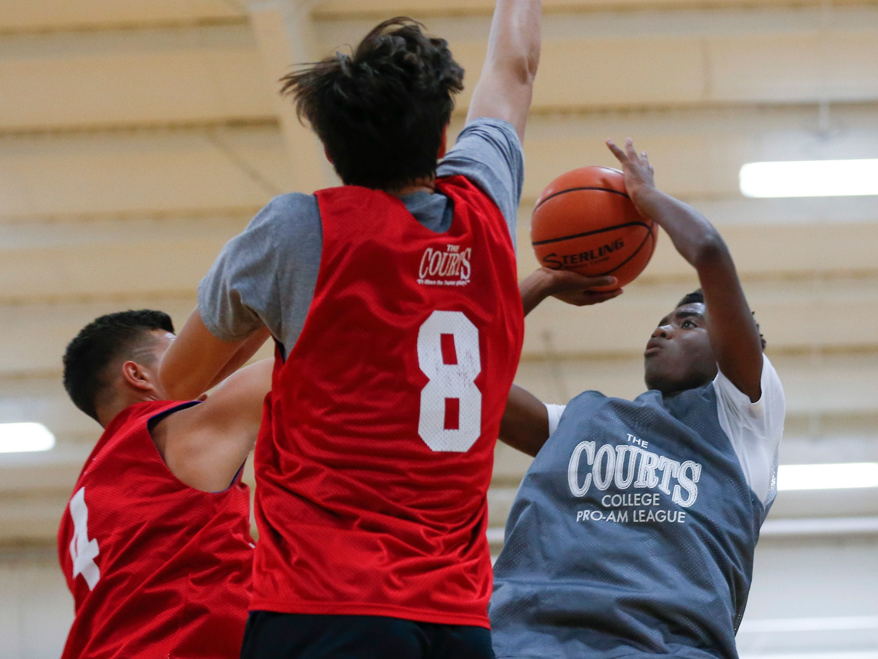 Anton Brookshire shoots a basket during a game at the 19th Annual Men's & Women's College Pro am League at The Courts on Wednesday, June 20, 2018.