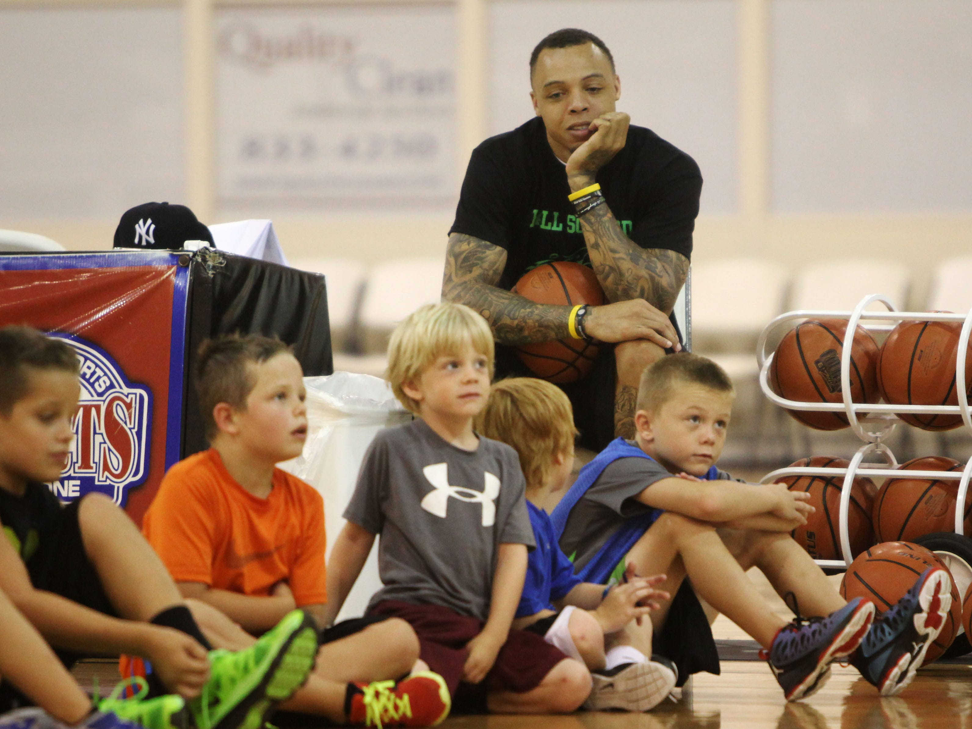 Former Bear Deven Mitchell gave a kids camp at The Courts on Monday, July 1, 2013.