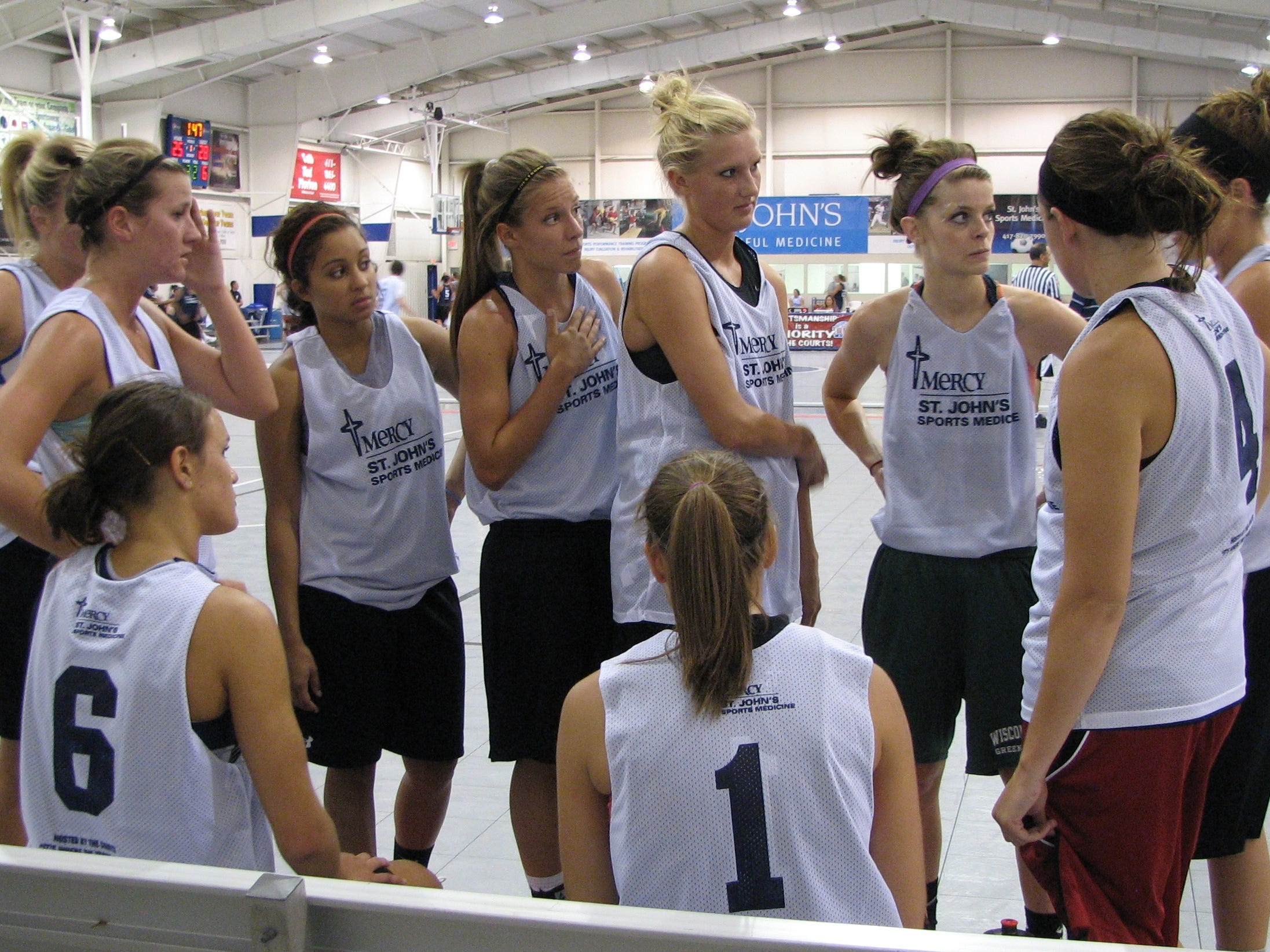Members of the Drury Lady Panthers gather for a tactical discussion at halftime of a game at The Courts Summer Pro-Am League on Wednesday, June 30, 2010.