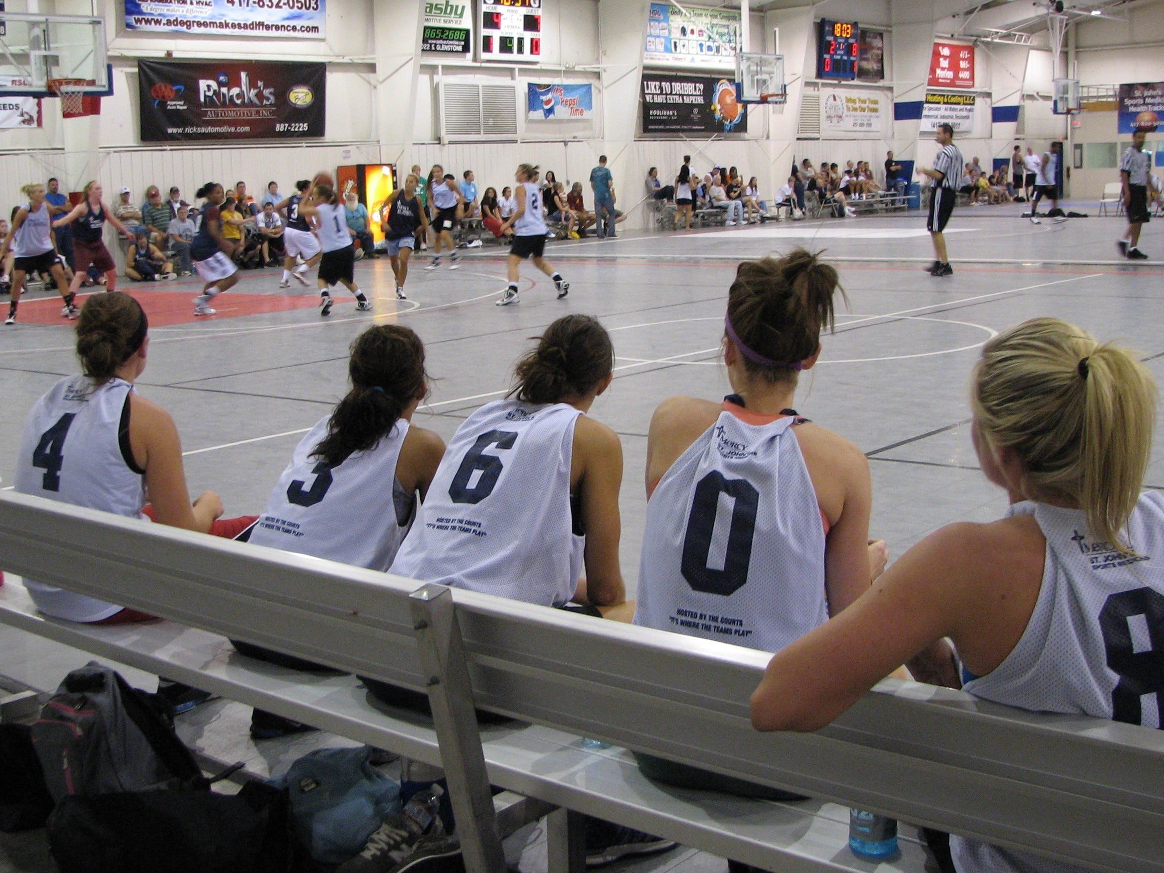 Members of the Drury Lady Panthers watch their teammates take on another team during a game at The Courts Summer Pro-Am League on Wednesday, June 30, 2010.