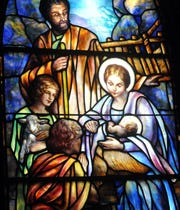 A stained glass window within Trinity Episcopal Church in Staunton portrays the Nativity.