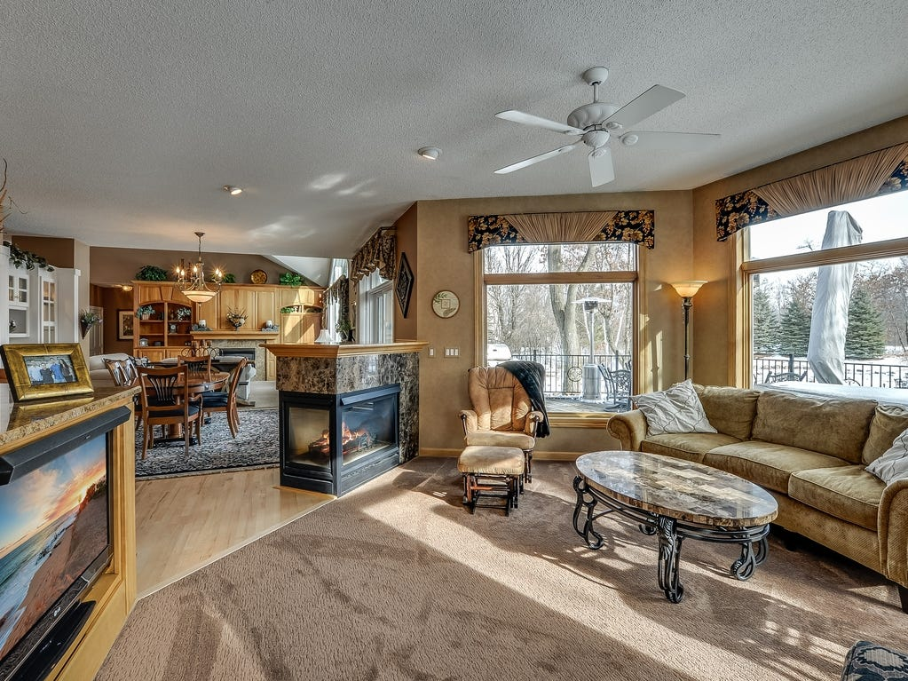Another beautiful fireplace has three open sides – facing into the dining room, family room and kitchen.