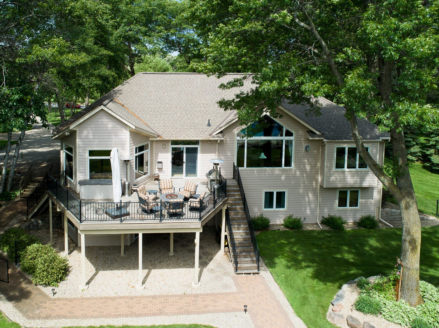 Surrounded by rock gardens and gorgeous landscaping, the property's spacious backyard patio and heated pool are sure to be a hub for all kinds of activity.